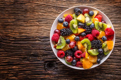 Fruit fresh mixed tropical fruit salad. Bowl of healthy fresh fruit salad - died and fitness concept.  Stock Photos