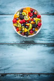 Fruit fresh mixed tropical fruit salad. Bowl of healthy fresh fruit salad - died and fitness concept.  royalty free stock photos