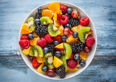 Fruit fresh mixed tropical fruit salad. Bowl of healthy fresh fruit salad - died and fitness concept Royalty Free Stock Photos