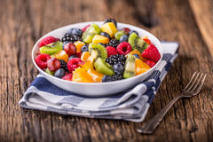 Fruit fresh mixed tropical fruit salad. Bowl of healthy fresh fruit salad - died and fitness concept.  royalty free stock images
