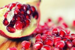 Fruit fresh red pomegranate. Seeds on table Royalty Free Stock Photos