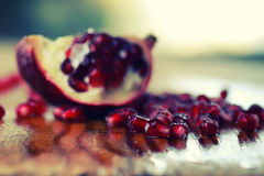 Fruit fresh red pomegranate. Seeds on wooden table Stock Image