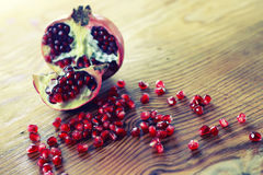 Fruit fresh red pomegranate. Seeds on wooden table Stock Photos