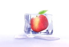 Fruit frozen in ice cube Royalty Free Stock Images