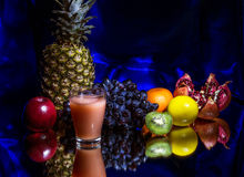 Fruit and fruit juice. Still life with pineapple, apples, grapes, kiwi, citrus, pomegranate and fruit juice Stock Photography