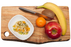 Fruit and fruit salad on cutting board Stock Photography