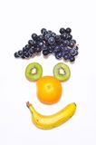 Fruit fun. Isolated Fruit forming a face Royalty Free Stock Photos