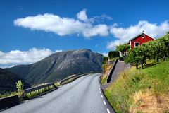 Fruit gardens and coastal road along the Hardanger fjord, Norway royalty free stock images