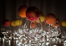 Fruit in a glass among the lights. Abstract art which i did ... those apples,lemons and oranges in a glass are interesting Stock Photo