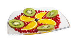 Fruit on a glass plate. Mixed fresh fruit on a plate Stock Photo