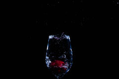 Fruit in a glass of water. Cherry fruit Water in the glass against a black background Stock Photography