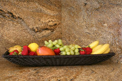 Fruit on a granite countertop. A basket of fruit on a kitchen countewrtop Royalty Free Stock Photo