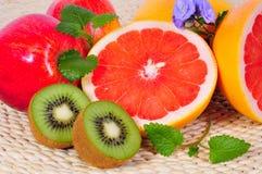 Fruit Grapefruit vitamins. Fruit Grapefruit Kiwi vitamins Nutrition Health Royalty Free Stock Images