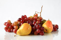 Fruit grapes and pears. Still life from grapes and pears on a light background Royalty Free Stock Image