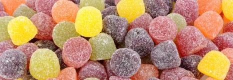 Fruit Gum Candy Background. Sweet sugar coated fruit gum candy background stock photo