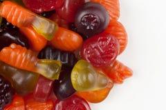 Fruit gummies. Assortment of sweet fruit gummies on white Royalty Free Stock Photo