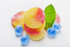 Fruit gums and mint leaf Stock Images