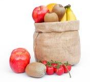 Fruit in gunny. Bag on white Stock Photos