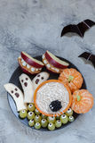 Fruit Halloween Treats. Banana Ghosts and Clementine Orange Pumpkins, Apple Monster Mounts and Spider Web Royalty Free Stock Photos