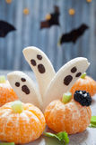 Fruit Halloween Treats. Banana Ghosts and Clementine Orange Pumpkins royalty free stock photo
