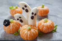 Fruit Halloween Treats. Banana Ghosts and Clementine Orange Pumpkins stock image