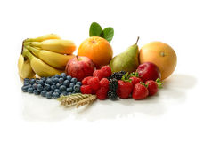 A Fruit Harvest. A fresh harvest of various colourful ripe fruits against a white background. Concept image for the harvest festival and/or a healthy diet. Copy Royalty Free Stock Image