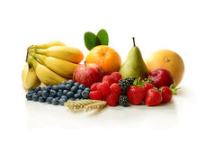 A Fruit Harvest. A fresh harvest of various colourful ripe fruits against a white background. Concept image for the harvest festival or a healthy diet. Copy Royalty Free Stock Images