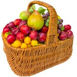 Basket with cherry plum and plums. Royalty Free Stock Photography