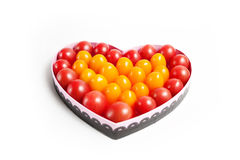 Fruit heart. Arranged in a heart-shaped pattern with tomatoes Stock Photo