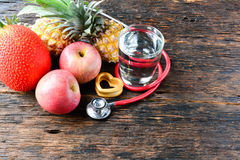 Fruit, heart, stethoscope and water glass for healthy and body s. Lim Royalty Free Stock Photography