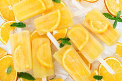 Fruit homemade popsicle with slices of orange Stock Image