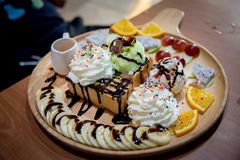 Fruit honey toast. dessert on the wood plate that is Toast and i Royalty Free Stock Photos