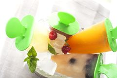 Fruit ice cream. In a pail decorated with berries and mint royalty free stock photography