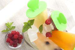 Fruit ice cream. In a pail decorated with berries and mint royalty free stock photo