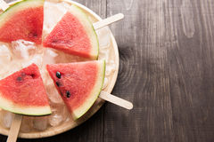 Fruit ice cream sliced watermelon on wooden background Stock Images