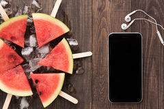 Fruit ice cream sliced watermelon on wooden background Royalty Free Stock Image
