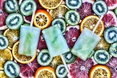 Concept: summer, heat, quenching thirst. Fruit ice, sliced fruit, kiwi, orange, grapefruit. Fruit ice, sliced fruit, kiwi, orange, grapefruit Concept summer Royalty Free Stock Images