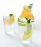 Fruit infused citrus drink in a jug or mug at a cafe Royalty Free Stock Photo