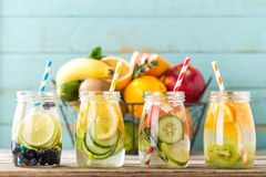 Fruit infused detox water in glass jars and ingredients. Variety of fruit infused detox water in glass jars for a healthy diet eating stock image