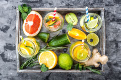 Fruit infused detox water in glass jars and ingredients Stock Photo