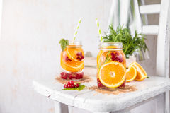 Fruit Infused Detox Water with orange red currants and rosemary. Cold Fruit Infused Detox Water with orange red currants and rosemary Royalty Free Stock Photo