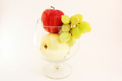 Fruit inside big drinking glasses Royalty Free Stock Images