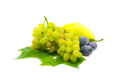 Fruit isolated on a white background. Vegetable and fruit still-life. Plums, grapes Royalty Free Stock Images