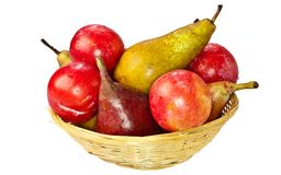 Fruit, isolated on white. Pears and plums in a basket Stock Images