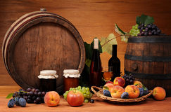 Fruit, jam, wine and wooden barrel Royalty Free Stock Images
