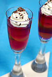 Fruit jelly. With whipped cream and bitter chocolate Stock Photography