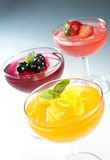 Fruit jelly. Jelly in the glass bowl top with fresh fruit and mint leaf Stock Photos