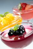 Fruit jelly. Jelly in the glass bowl top with fresh fruit and mint leaf Stock Images