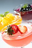 Fruit jelly. Jelly in the glass bowl top with fresh fruit and mint leaf Stock Photo