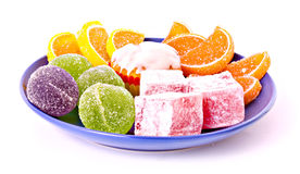 Fruit jelly on blue plate Stock Photography